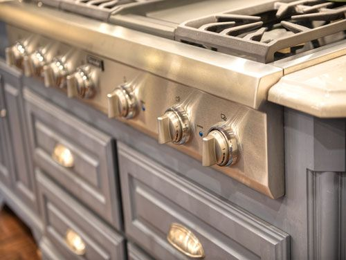 gourmet gas range set in blue french country kitchen cabinets