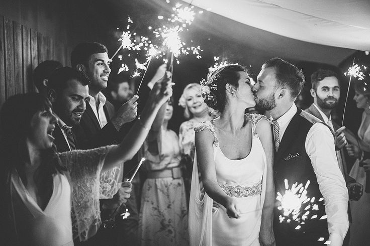 A contemporary camping wedding at Fforest wedding venue in Wales with a Sanyukta Shrestha bridal gown and a colour pop bouquet by Samuel Docker Photography