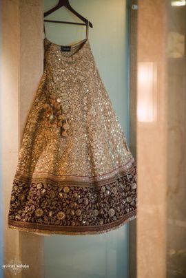 Bridal Lehengas - Gold and Maroon Lehenga | WedMeGood Beautiful Gold Lehenga by Sabyasachi with mirror work, and Maroon broad border with gold embroidery. Such beauty! #wedmegood #bridal #lehenga