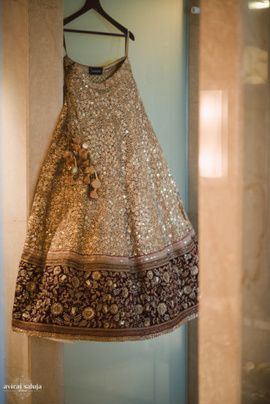 Bridal Lehengas - Gold and Maroon Lehenga | WedMeGood Beautiful Gold Lehenga by Sabyasachi with mirror work, and Maroon broad border with gold embroidery. Such beauty! #wedmegood #bridal #lehenga