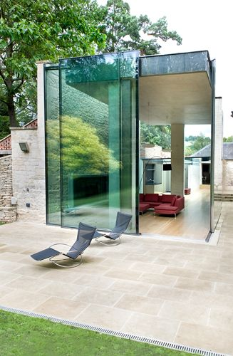 Stunning transparent orangery at Woodchester House in Gloucestershire by Robert Grace Architecture