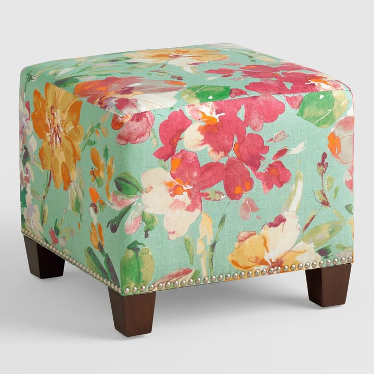 Featuring a bold watercolor-style floral motif on a light blue ground, our plush, custom-made ottoman is handcrafted with 100% linen upholstery and nail trim. Pair two ottomans at the foot of a bed for dramatic seating and coordinate with our bed or headboard in the same custom fabric for a pulled together look.