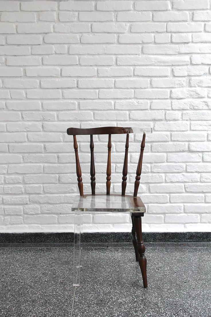 This clever chair uses clear acrylic to blend into where parts of the original wooden chair had perished.
