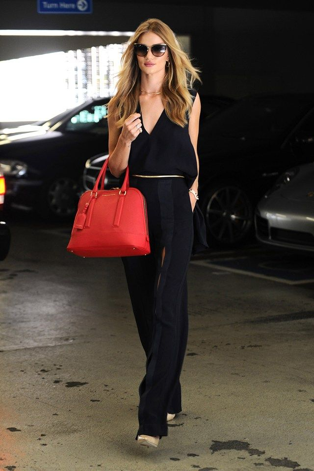 Best dressed - Rosie Huntington-Whiteley in a black jumpsuit and carrying a Kurt Geiger handbag