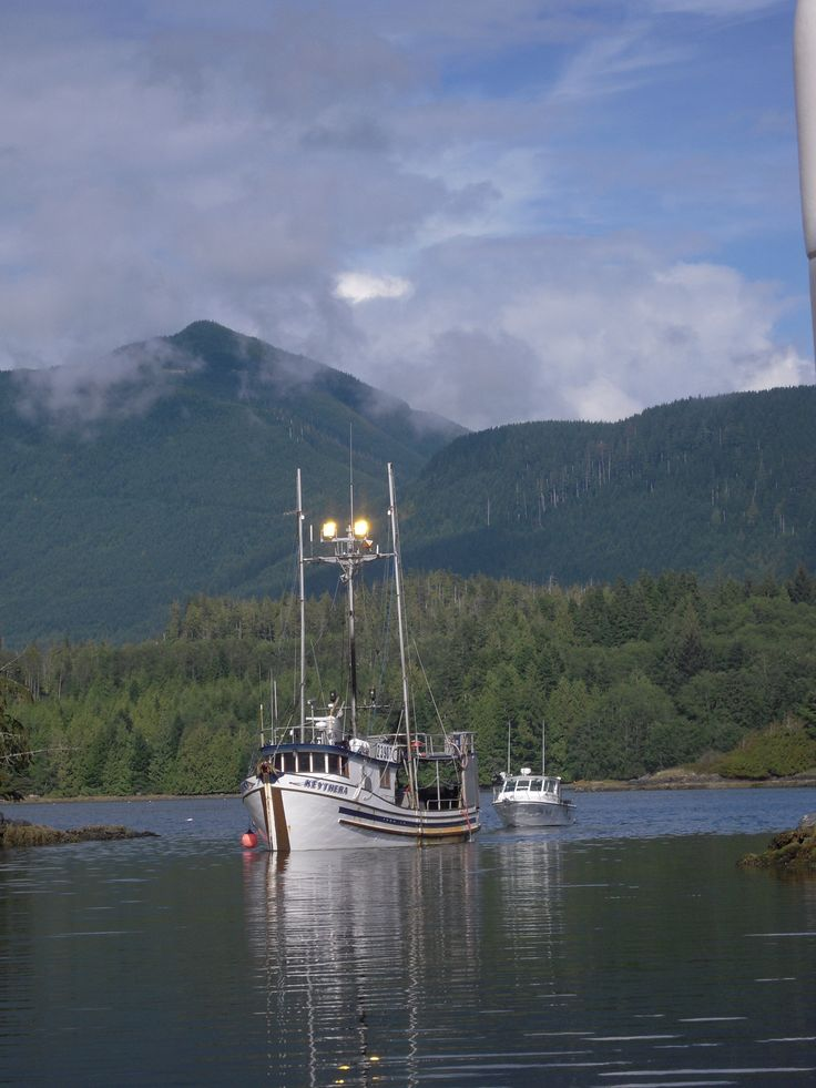 FISHERMEN COMING HOME.  UCLUELET BAY, B.C.