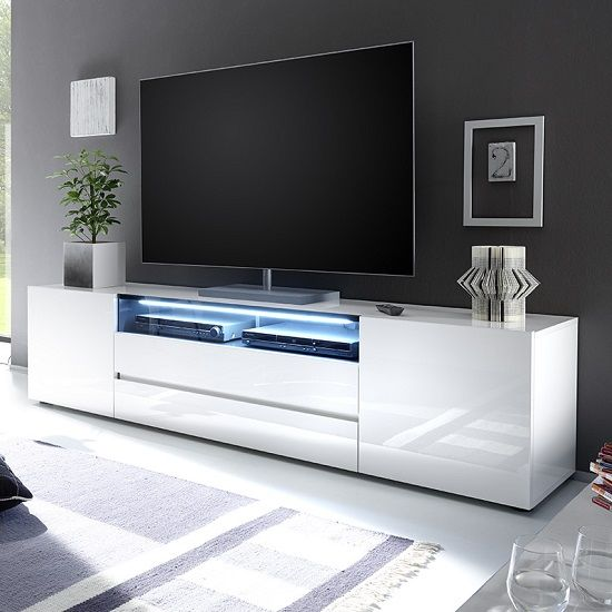 Genie Wide LCD TV Stand In White High Gloss With 2 Doors And 2 Drawers also one Black Glass Fronts Lid and LED Lighting look beautiful in any modern decor Finish: White High Gloss And Glass Feature...
