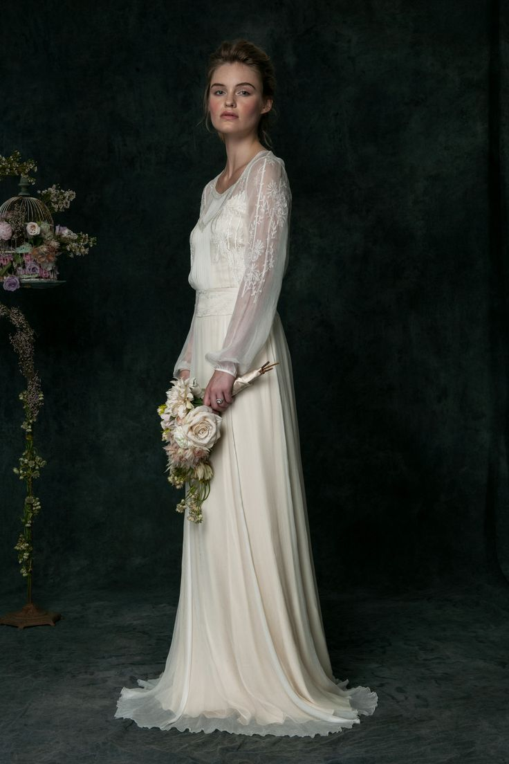 VT6310 l Our penchant for hand embroidery is well showcased in this long sleeved piece. Elaborate and elegant, this silk chiffon dress lends itself as the signature style for us this season. The easy fit paired with a dropped waist will surely connect with a bride who appreciates its quiet complexity and subtle sophistication.