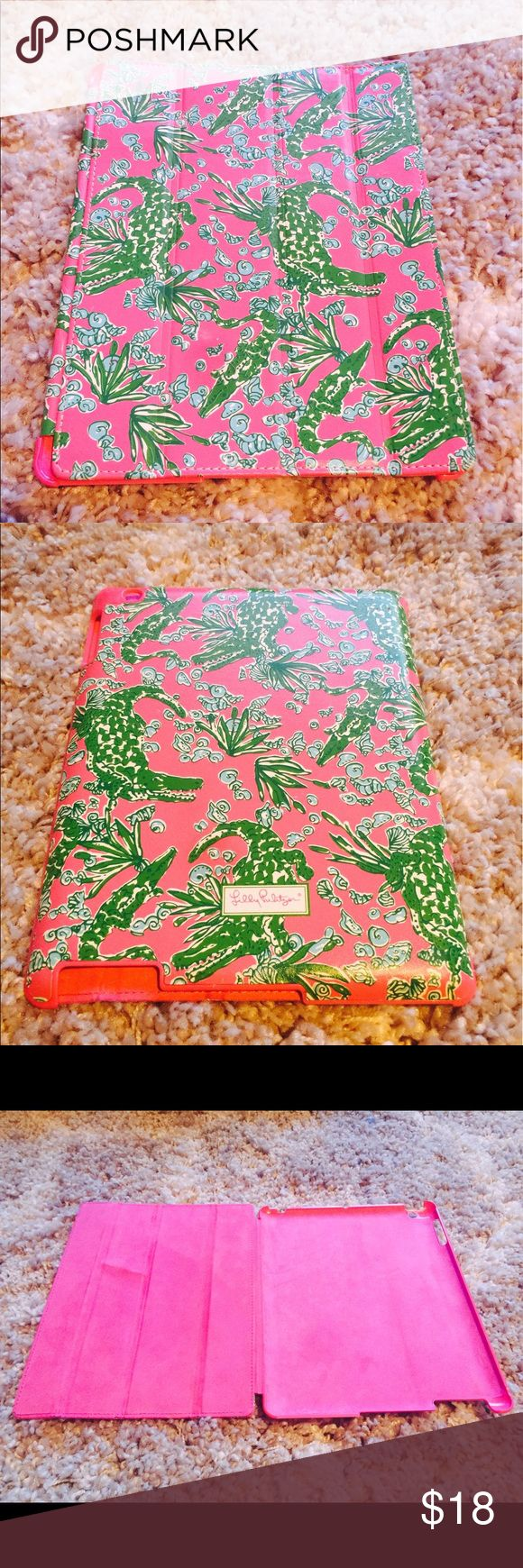 Alligator Print Lilly Pulitzer iPad Case Pink and green alligator print Lilly Pulitzer iPad Case. Small bend on inside cover panel, however should not affect protection of device (shown in photo). All orders shipped the same or next business day! Lilly Pulitzer Accessories Tablet Cases