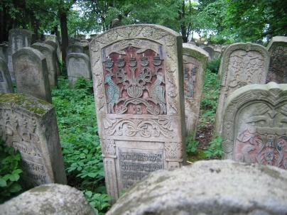 candlesticks on stone--representing the woman in Jewish tombstone art .