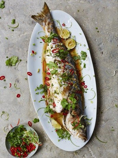 Asian Steamed Sea Bass recipe from Jamie Oliver, the king of fabulous flavors. Imagine red chili, fresh ginger, and sesame melting together in your mouth...