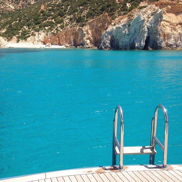 Swimming in Paradise , at Polyaigos island (Πολύαιγος). The combination of magical crystal-clear water & wild natural beauty makes it ... A dreaming place . Only accessible by yacht .... One of a kind