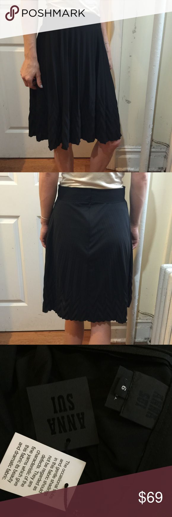 NWT Anna Sui Black Pleated Skirt Anna Sui new with tags skirt in black with visible textured pleats on bottom hem. Skirt is circle style and not lined and has zipper closure with hook and eyes above. Size 6. Anna Sui Skirts A-Line or Full