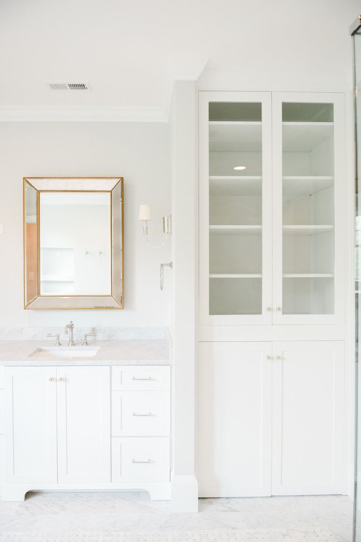 Option for the hall bath...rather than a closet.   Master Bathroom Cabinetry || Studio McGee