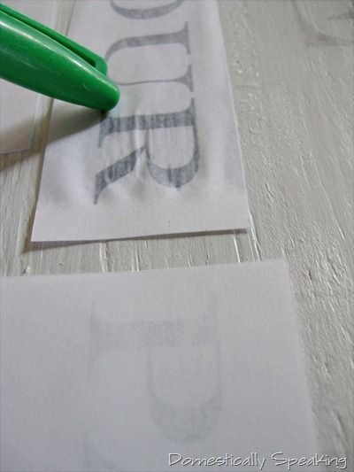 WHO KNEW!! you print out words on basic white paper, but in mirror image form… lay them on the wood… with a damp paint brush wet the paper on top of the words… use the cap of a sharpie to rub on top of the letters to help them transfer … then remove the paper and stand in shock and awe!
