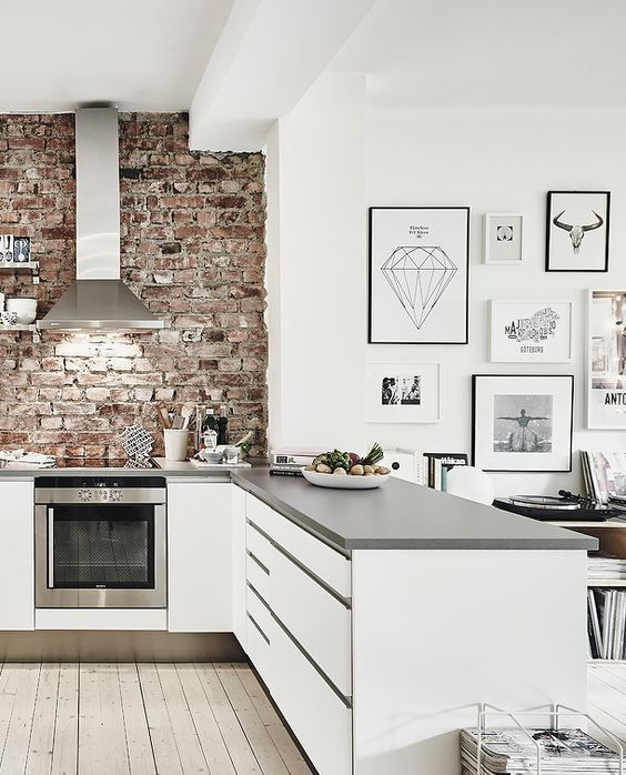Scandinavian kitchen with exposed brick feature wall