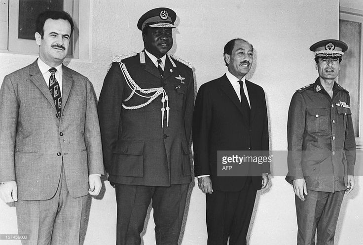President of Uganda Idi Amin Dada (2nd-L) poses with some of the Organization of African Unity (OUA, from left) Syrian President Hafez al-Assad, Egyptian President Anwar El Sadat and Lybian leader Muammar Kadhafi in juin 1972 in Kampala during an OUA summit. Idi Amin's reign of terror lasted from 1971 when he seized power from Milton Obote, to 13 April 1979, when Tanzanian troops and exiled Ugandans stormed Kampala and removed him from power. The self-styled field marshal settled then in…