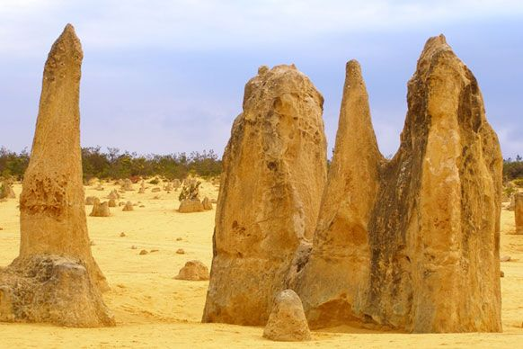 Best for sand gropers - Nambung National Park  Australia has plenty of sandy desert country, but the most accessible, and unusual, is the Pinnacles Desert in Nambung National Park just three hours drive north of Perth. Here thousands of huge limestone pillars rise out of a stark landscape of yellow sand. An added bonus is that this desert is beside the sea, —nice! (Image credit: Lee Atkinson)