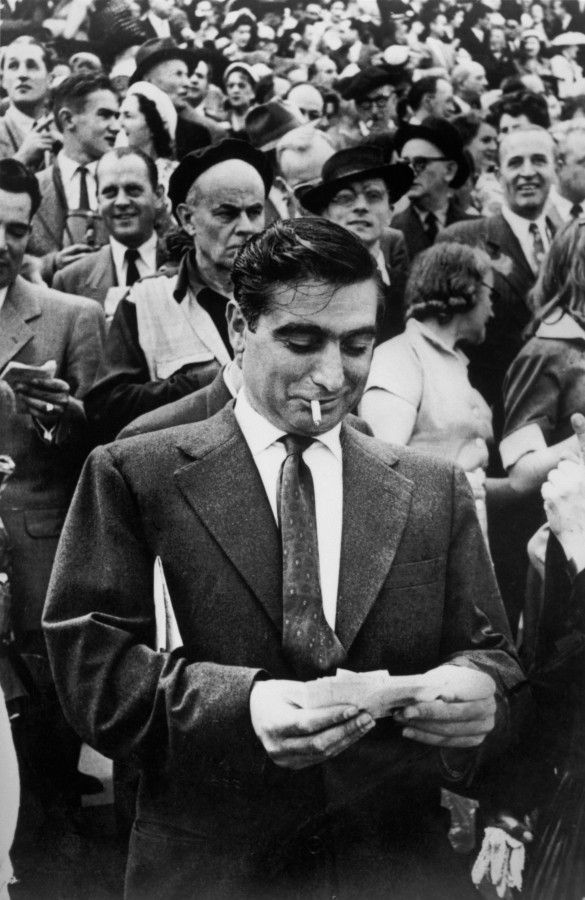 Henri Cartier Bresson- 1953 Title: Robert Capa, Longchamp Racetrack, Paris