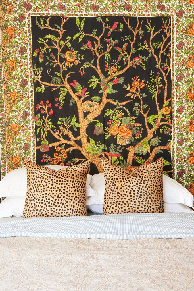 In lieu of a headboard, Mr. Bazner stretched a tapestry he picked up for $20 from the ceiling to the floor along the full width of the bed, then paired it with some cheetah-print throw pillows to make the whole thing seem more expensive.