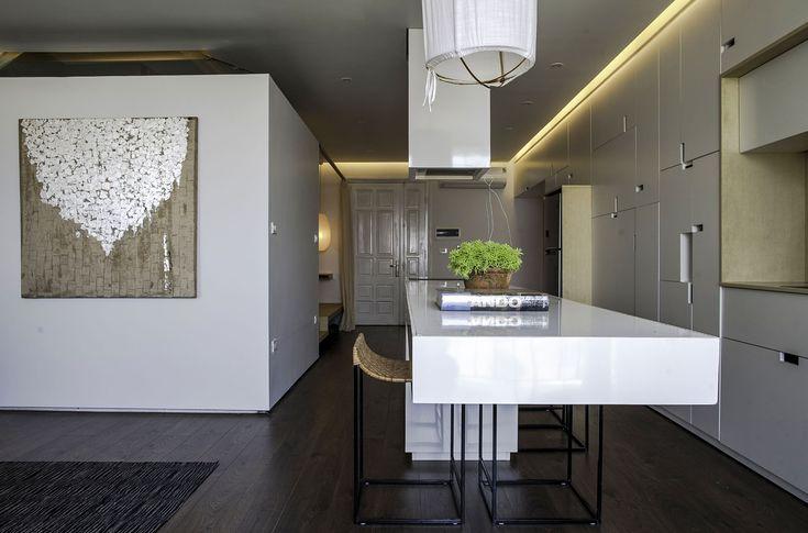Apartment Renovation under Hanoi Among Modern White Kitchen Furniture Design With White Pendant Lighting Decoration Ideas