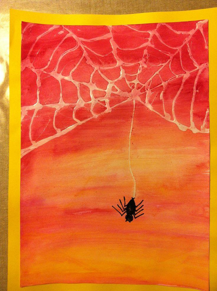 Spin met web gemaakt van  sterke lijm, goed laten drogen, dan ecoline erover…
