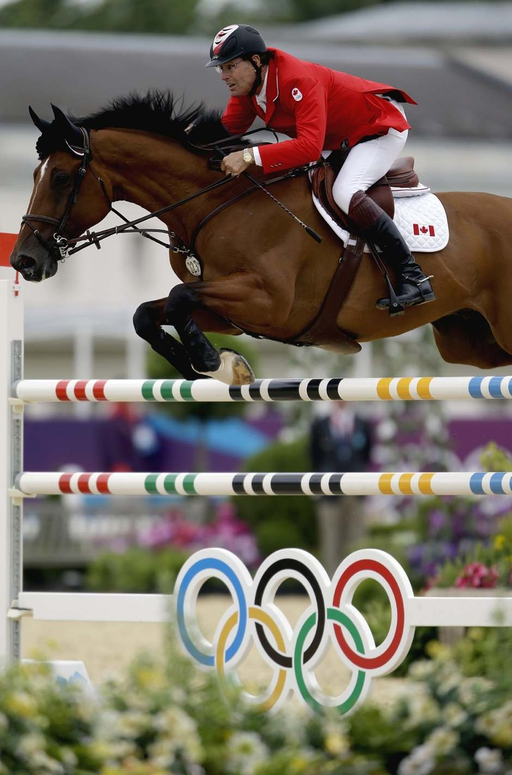 Equestrian -- Individual Jumping (Switzerland): 65 year old Ian Millar from Canada, jumping with his horse, Star Power. (Image Source: David Goldman/AP Photo) #London2012