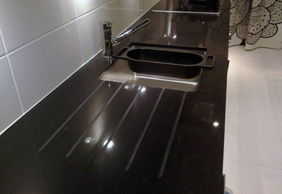 Under mount stainless steel sink with integrated built in draining area Caesarstone