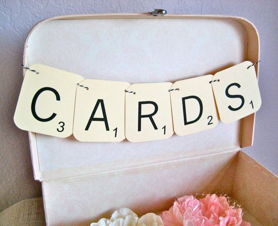 Maybe not that big but like how they've strung them together.  CARDS Wedding Garland Sign  Decoration by PurplePeonyCouture, $7.95