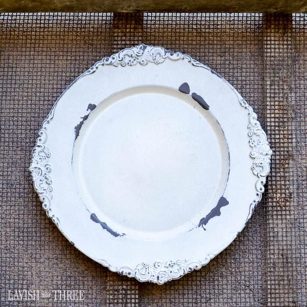 Shabby vintage like distressed antique white charger plate. Perfect for a country, rustic or romantic Victorian wedding. Or use as centerpiece to display candles.