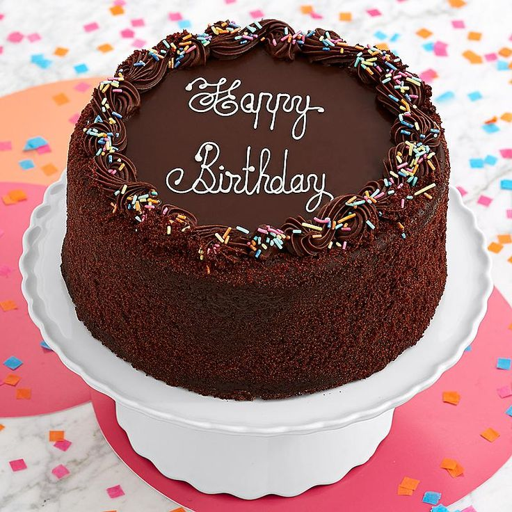 "This is the ultimate chocolate birthday cake! A high three layered chocolate cake is filled with rich chocolate cream. It is surrounded by chocolate glaze, appointed with an elegant chocolate border, dusted with festive sprinkles, and decorated with ""Happy Birthday""."