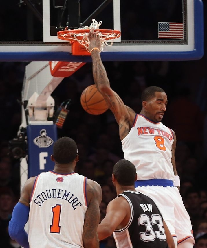 PLAY OF THE MONTH!  J.R. Smith #8 of the New York Knicks scores a basket behind his head late in the fourth quarter against the San Antonio Spurs at Madison Square Garden on January 3, 2013 in New York City