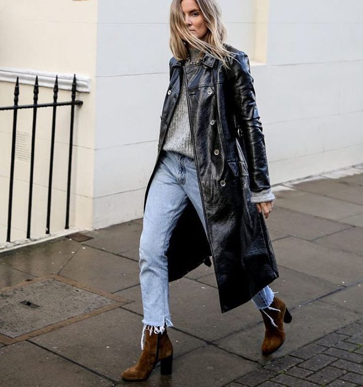 If you were one of the lucky ones to get your hands on this patent coat from Alexa Chung's Marks & Spencer collection (or any other iteration of the look), let it stand out by pairing it with a simple ribbed sweater, cropped, frayed hem, light-wash jeans, and some chunky ankle boots. #refinery29 http://www.refinery29.com/winter-layering-street-style-trend-photos#slide-4