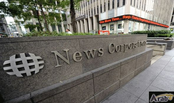 News Corp swings to loss on write-downs