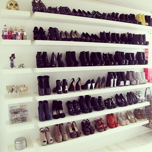 I wish!! Brilliant. What every #shoeobsessed girl should have! Install shelving along a blank wall in your apt! Not one for power tools? Line up bookshelves instead. #bookshelvessolutions #shoestoragesolutions