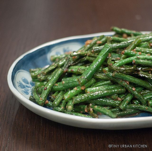 My favorite way to prepare green beans; a little oil, garlic, soy sauce, salt and a hot wok go a long way!