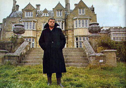 Oliver Reed in front of his home, Broome Hall