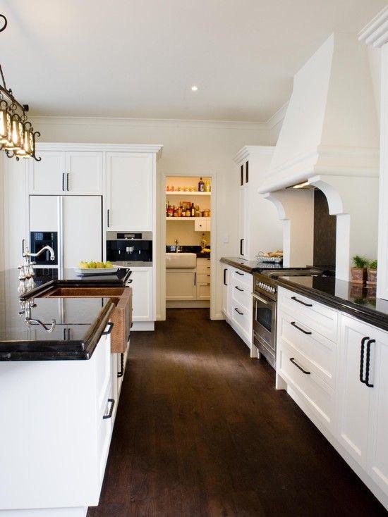 Black granite countertop white cabinet design pictures for Spanish style kitchen ideas