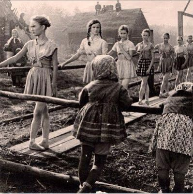 Incredible photo... Russian ballet class during WWII.  Even in the rubble and ash of war, there is still room for art.