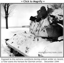 M10 tank destroyer,battle of the bulge. Tanker scans the horizon for German Armour.