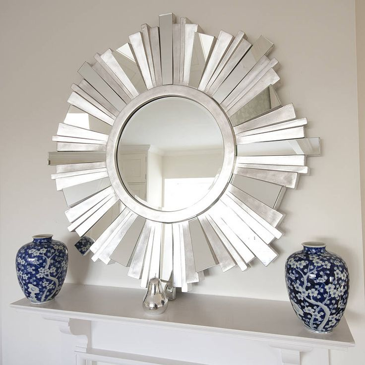 A fabulous on trend sunburst mirror that brings light and sparkle to your room. Shown here above a mantlepiece, this classic silver sunburst mirror would grace the wall in your living room, in your bedroom, or equally at home as a hallway mirror. The finish on the segment surround is part distressed silver, part mirror glass. The offset segments in the frame, and the ageing add to dramatic effect that this mirror will bring to your room.This silver round contemporary mirror is made of ...