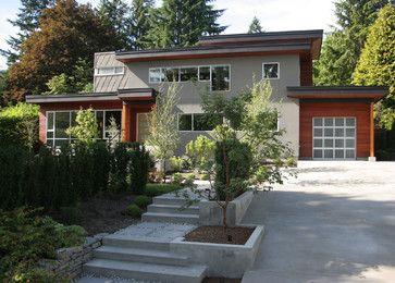Sloped Driveway with the challenge of creating planting pockets that are easy to manage.