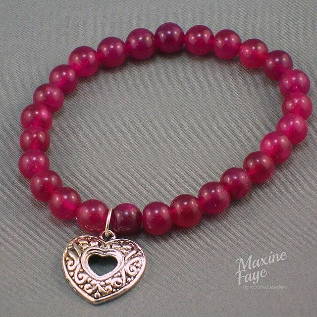 This Magenta dyed approx 6mm Jade gemstone bracelet has an approx 17.5 cm internal measurement. This simple design is completed with an open style embossed heart charm.  Similar designs may be available instore  https://www.maxinefaye.com.au/shop/