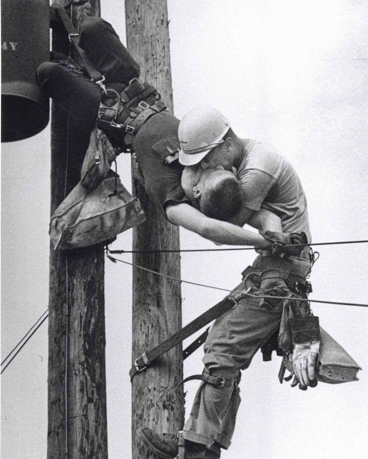 """""""The Kiss of Life"""". This iconic photo shows a utility worker receiving mouth-to-mouth after being electrocuted. He survived. (1967)."""
