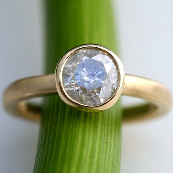 """One of the most simple and elegant rings I have seen and it's pretty. But I don't think I would like to wear it for the rest of my life.  """"Unique one carat white diamond ring."""""""