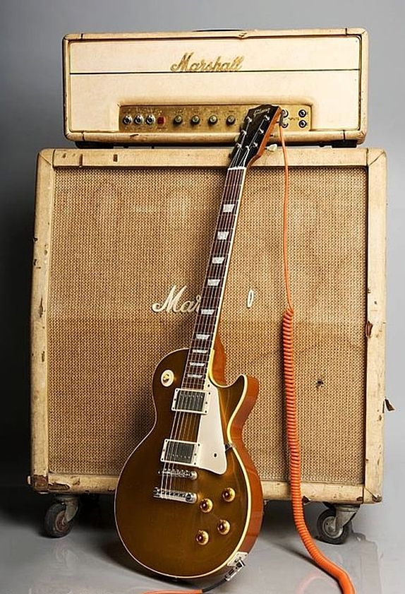 Gibson Les Paul and Marshall half-stack. At least they got a case for the…