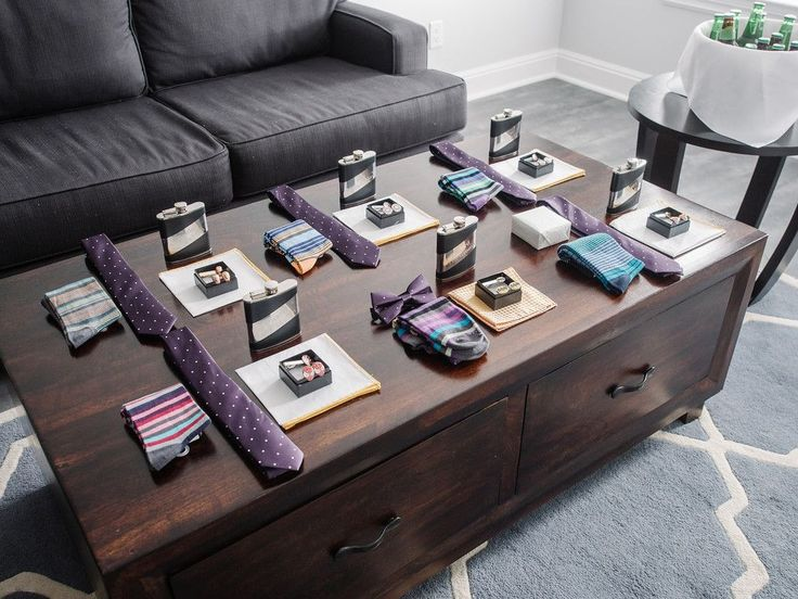 Groomsmen's gifts all set up! We provided their shirts, socks, ties, pocket squares and super hero cufflinks complete with personalized flask.