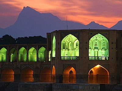 The stunning Khaju bridge of Isfahan, Iran, built in the 17th century as a dam across the Zayandeh river. With two gleaming storeys of elegantly tiled arcades and two large pavilions built for Shah Abbas II, it's an enchanting sight