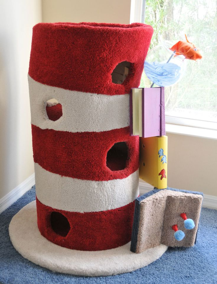 Paying homage to one of the greatest children's book writers of modern  times…  This cat tower has a 36″ diameter base with a 20″ diameter body that stands  44″ tall.  Door stops clad in red felt and blue poms make for fun playthings at ground  level, while the middle book functions as a vertical scratching pad.  Alas, this model is not for sale, due to obvious copyright infringement.