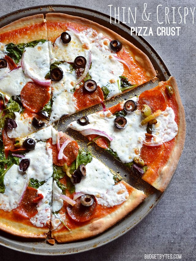 The perfect Thin and Crispy Pizza Crust - No rise time required! BudgetBytes.com