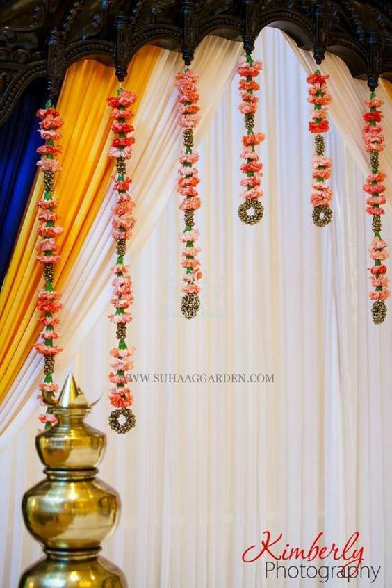 Love the ghunghroo with flower strings! traditional with a twist <3  #Decor #indianWeddings | curated by #WittyVows the ultimate guide for the Indian bride | www.wittyvows.com